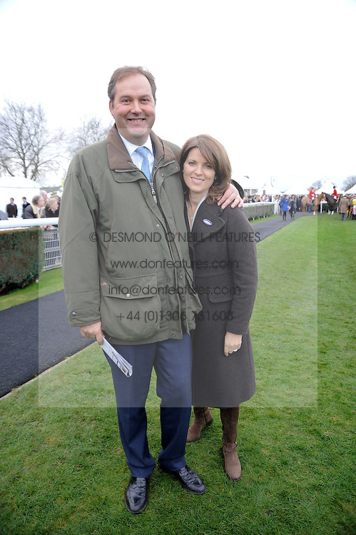 The HON.HARRY & MRS HERBERT at the Hennessy Gold Cup 2009 held at Newbury Racecourse, Berkshire on 28th November 2009.
