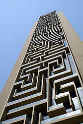 Detail of intricate architecture of skyscraper facade in Dubai United Arab Emirates