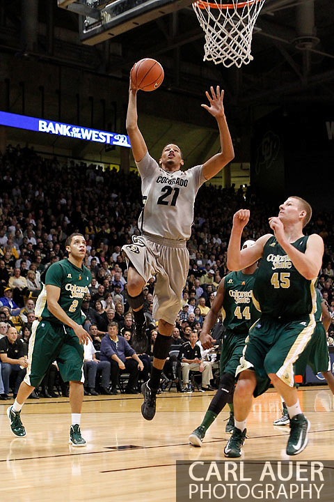 December 5, 2012: Colorado Buffaloes junior forward ANDRÉ ROBERSON (21) splits the defense of Colorado State Rams sophomore guard DANIEL BEJARANO (2) and senior forward/center COLTON IVERSON (45) and heads to the hoop for a lay-up in the NCAA Basketball game between the Colorado State Rams and the Colorado Buffaloes at the Coors Event Center in Boulder Colorado