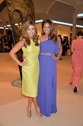 Left to right, ZOE HARDMAN and KATY WICKREMESINGHE at the Masterpiece Marie Curie Party supported by Jeager-LeCoultre held at the South Grounds of The Royal Hospital Chelsea, London on 30th June 2014.