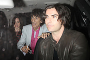 29.MARCH. LONDON<br /> <br /> RONNIE WOOD AND KELLY JONES LEAVING THE PAUL MCCARTNEY GIG FOR THE CANCER TRUST IN THE ROYAL ALBERT HALL IN LONDON<br /> <br /> BYLINE: EDBIMAGEARCHIVE.COM<br /> <br /> *THIS IMAGE IS STRICTLY FOR UK NEWSPAPERS AND MAGAZINES ONLY*<br /> *FOR WORLD WIDE SALES AND WEB USE PLEASE CONTACT EDBIMAGEARCHIVE - 0208 954 5968*