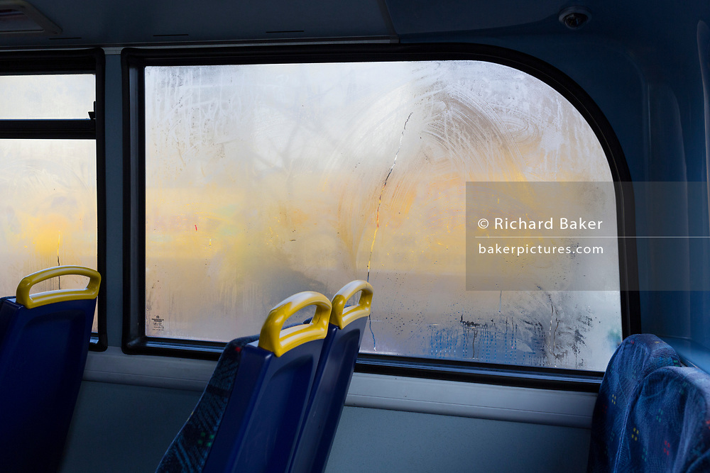Steam-up windows on the top deck of a double-decker bus in central London, on 7th December 2017, in London England.