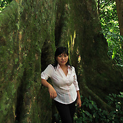 Conservationist Vu Thi Quyen leans on a giant tree in Cuc Phuong National Park, 140 kilometers south of Hanoi, Vietnam. The 31-year-old Quyen started Vietnam's first domestic wildlife conservation group, Education for Nature Vietnam (ENV), four years ago. Now based in Hanoi, she is at the forefront of a growing movement to help Vietnamese understand the importance of conserving wildlife in one of Asia's most ecologically diverse nations. ..