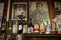 """AFFILE, ITALY - 23 AUGUST 2012: A bottle of red wine with a portrait of Benitor Mussolini is on the sheld of Bar San Sebastiano in Affile, a town with a population of 1,600 80km east of Rome, on August 23, 2012. A mausoleum and park, dedicated to the memory of Fascist Field Marshall Rodolfo Graziani, has recently been opened in the Italian town of Affile. At a cost of €127,000 to local taxpayers, the mayor Ercole Viri has expressed hope that the site will become as 'famous and as popular as Predappio' – the burial place of Mussolini which has become a shrine to neo-Fascists. Rodolfo Graziani was the youngest colonel in the Regio Esercito (Royal Italian Army), known as the """"Butcher of Fezzan"""" and the """"Butcher of Ethiopia"""" for the brutal military campaigns and gas attacks he led in Libya and Ethiopia under the dictatorship of Benito Mussolini under which he then became Minister of Defence from 1943 to 1945."""