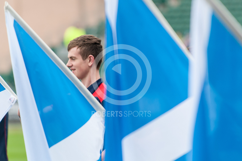Flag bearers await the arrival of the Scotland team. Action from the IRB Emirates Airline Glasgow 7s at Scotstoun in Glasgow. 3 May 2014. (c) Paul J Roberts / Sportpix.org.uk