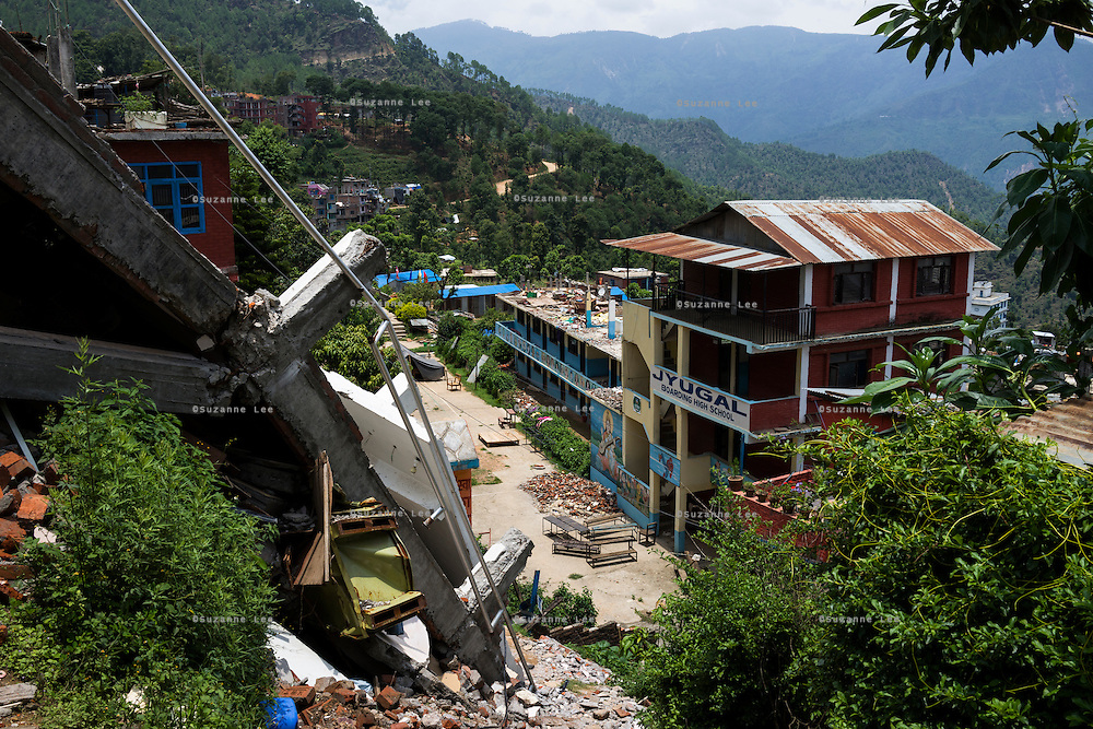 The now defunct Jyugal school building which was badly damaged during the earthquake in Chautara, Sindhupalchowk, Nepal on 29 June 2015. One of its students, Aastha (6) was buried under the rubble together with her mother but Aastha survived while her mother died on the spot. As their father Ratna Baniya (28) cannot care for the three young children on his own, SOS Childrens Villages has since been supporting the grandmother with financial and social support so that she can manage to raise the children comfortably and ensure that they will all be schooled. Photo by Suzanne Lee for SOS Children's Villages