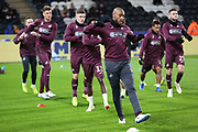 Swansea City midfielder Leroy Fer (8) and his team mates in warm up during the EFL Sky Bet Championship match between Hull City and Swansea City at the KCOM Stadium, Kingston upon Hull, England on 22 December 2018.