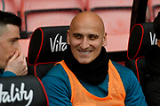 Jonjo Shelvey (8) of Newcastle United has a cheeky smile on his face as he sits on the sunstitutes bench during the Premier League match between Bournemouth and Newcastle United at the Vitality Stadium, Bournemouth, England on 16 March 2019.