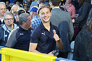 AFC Wimbledon defender Tom Scott (23) watching the game during the EFL Carabao Cup 2nd round match between AFC Wimbledon and West Ham United at the Cherry Red Records Stadium, Kingston, England on 28 August 2018.