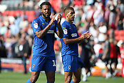 AFC Wimbledon midfielder Tom Soares (19) and AFC Wimbledon defender Tennai Watson (2) applauds the travelling fans during the EFL Sky Bet League 1 match between Fleetwood Town and AFC Wimbledon at the Highbury Stadium, Fleetwood, England on 4 August 2018. Picture by Craig Galloway.