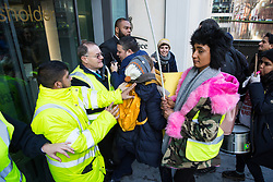 London, UK. 22nd January, 2019. Members of the United Voices of the World (UVW) trade union representing receptionists, security guards and cleaners at the Ministry of Justice (MoJ) try to storm the entrance of the Home Office after beginning a coordinated strike for the London Living Wage of £10.55 per hour and parity of sick pay and annual leave allowance with civil servants. The strike is being coordinated with support staff at the Department for Business, Energy and Industrial Strategy (BEIS) from the Public and Commercial Services (PCS) union.