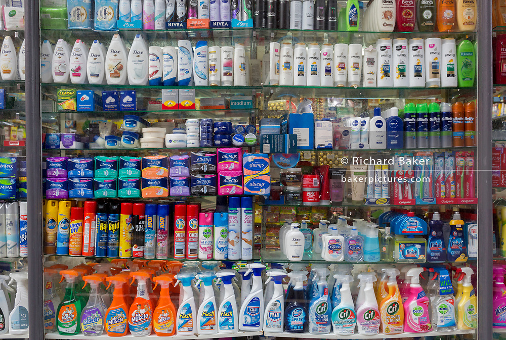 A local supermarket window display showing the retail products being sold in a Kensington convenience store, on 30th December 2018, in London England.