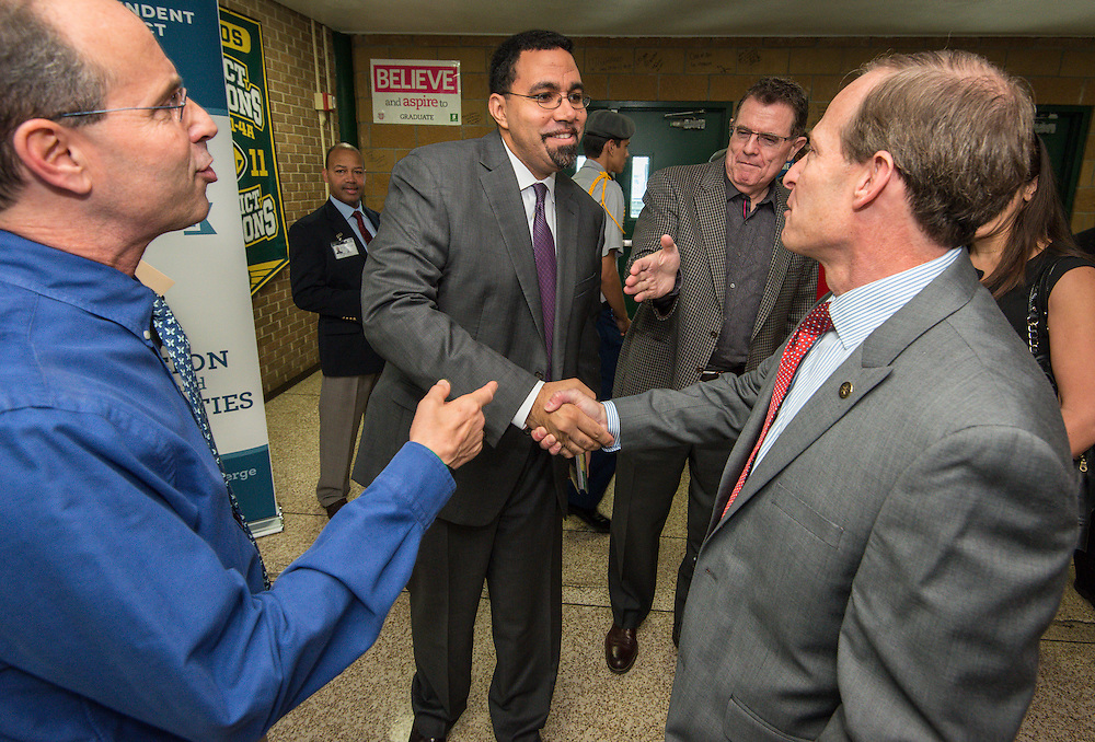 Acting US Secretary of Education John King is greeted by Robert Gasparello, left, Trustee Greg Meyers, right and Houston ISD Superintendent Dr. Terry Grier, back, for a tour of Sharpstown High School, January 15, 2016.