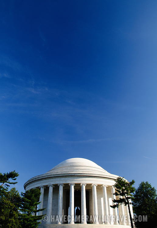 The Jefferson Memorial against a clear blue sky, with a large area of copyspace.