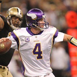 Jan 24, 2010; New Orleans, LA, USA; Minnesota Vikings quarterback Brett Favre (4) is pressured by New Orleans Saints defensive end Will Smith (91)during a 31-28 overtime victory by the New Orleans Saints over the Minnesota Vikings in the 2010 NFC Championship game at the Louisiana Superdome. Mandatory Credit: Derick E. Hingle-US PRESSWIRE