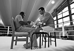 07.06.2011, Stanglwirt, Going, AUT, Wladimir Klitschko, Training, im Bild Trainer Emanuel Steward bandagiert seinem schützling Wladimir Klitschko (R) die Händeduring a training session at Hotel Stanglwirt, Going, Austria on 7/6/2011. EXPA Pictures © 2011, PhotoCredit: EXPA/ J. Groder