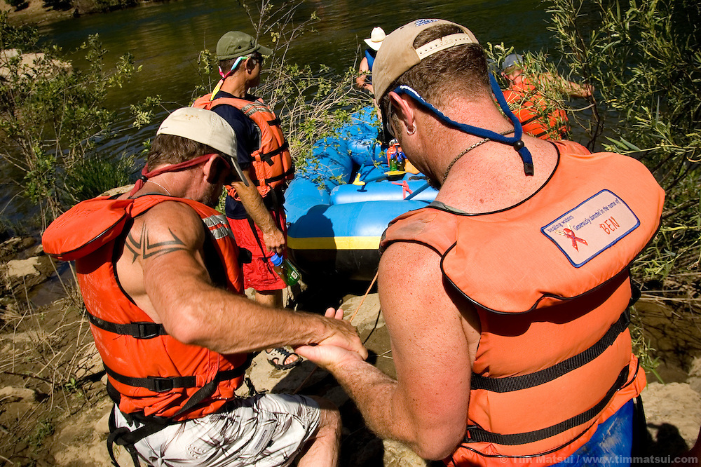 SATURDAY JULY 8, 2006 - LOTUS, CA  James Girard, right, helps Brent Gaddy, left, who suffers from medication-induced dizziness at the Healing Waters weekend retreat, a non profit whose mission is to empower, inspire and enrich the lives of people challenging HIV/AIDS through wilderness adventures, on Saturday, July 8, 2006 on the South Fork of the American River in Calif.
