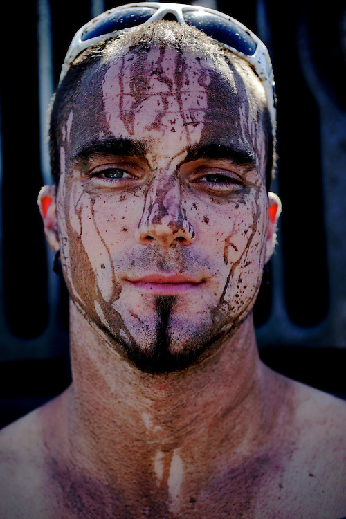 Mud drips down the face of one of the race drivers after finishing a lap at the Redneck Yacht Club in Punta Gorda, Fla. Photo by: Greg Kahn