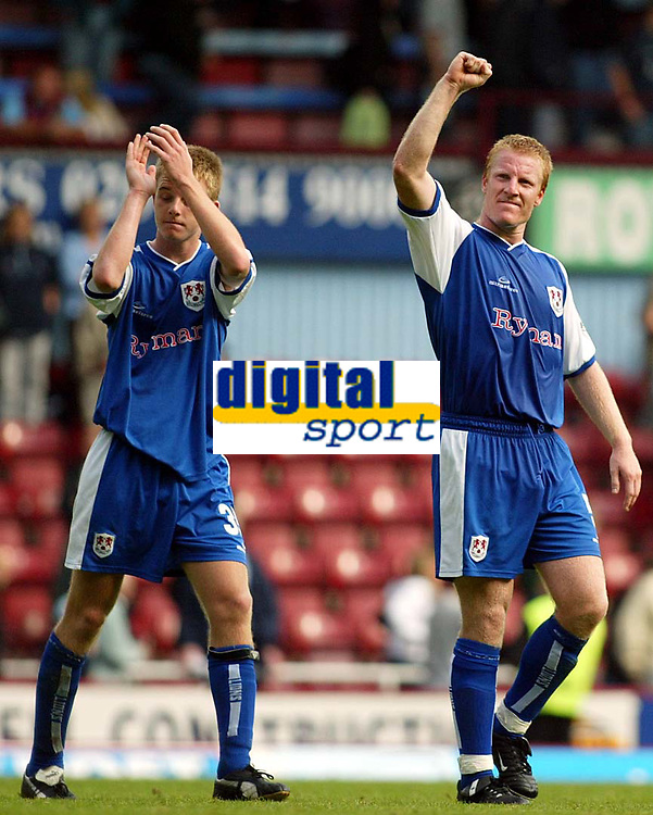 Photograph: Scott Heavey.<br />West Ham United v Millwall. Nationwide Division 1. 28/09/2003.<br />Stuart Nerthercott (Right) and Tony Craig applaud the travelling fans.