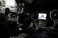 Syria. FSA fighters are seen inside a cave used as shelter by the Free Syrian Army in a village in Aleppo's province, as outside, the regime forces are shelling the place. ALESSIO ROMENZI