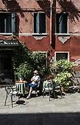 Venice, man outside his hotel