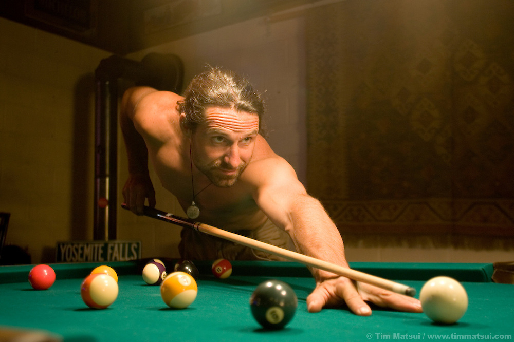 Alexander Huber plays pool after a day spent filming Am Limit, a Lotus Film production, about the climbing brothers Alexander and Thomas Huber and their attempt to break the speed climbing record on the Nose of El Capitan in Yosemite National Park, California, USA.