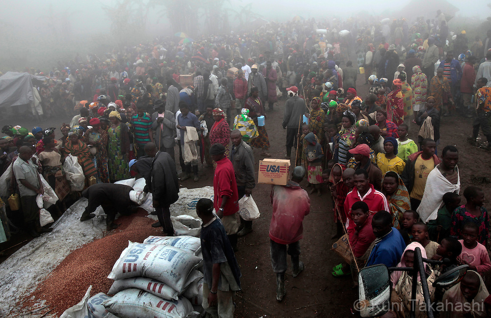 Refugees line up for food distribution at Mpati IDP camp, about 100 km northwest of Goma, DRC on April 23, 2010. The long war had involved 9 African nations and claimed an estimated three million lives as a result of fighting or disease and malnutrition..Photo by Kuni Takahashi