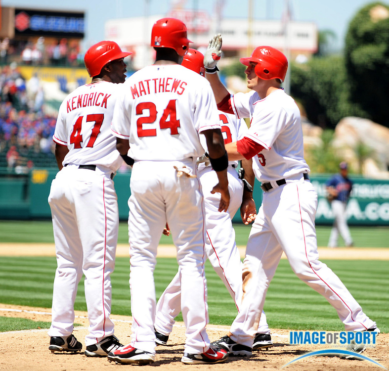 Jul 23, 2008; Anaheim, CA, USA; Los Angeles Angels catcher Jeff Mathis (5), right, is congratulated by Howie Kendrick (47), Gary Matthews Jr. (24) and Garret Anderson (16) after hitting a grand slam home run in the fifth inning of the 14-11 victory over the Cleveland Indians at Angel Stadium. Mandatory Credit: Kirby Lee/Image of Sport-US PRESSWIRE