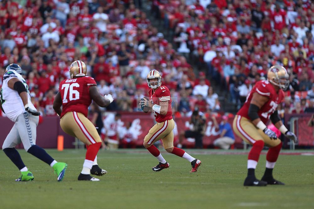 San Francisco 49ers quarterback Alex Smith (11) of the San Francisco 49ers passes against the Seattle Seahawks on Thursday, Oct. 18, 2012 at Candlestick Park in San Francisco. (AP Photo/Jed Jacobsohn)