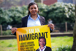 © Licensed to London News Pictures. 08/04/2015. LONDON, UK. (L to R) Mary Sithole from Zimbabwe and a customer assistant working for National Rail taking part at 'I am an Immigrant' poster campaign launch in London on Wednesday, 8 April 2015. The posters feature images of 15 immigrants and will appear in 400 London tube stations and 550 national rail stations across the country. Photo credit : Tolga Akmen/LNP