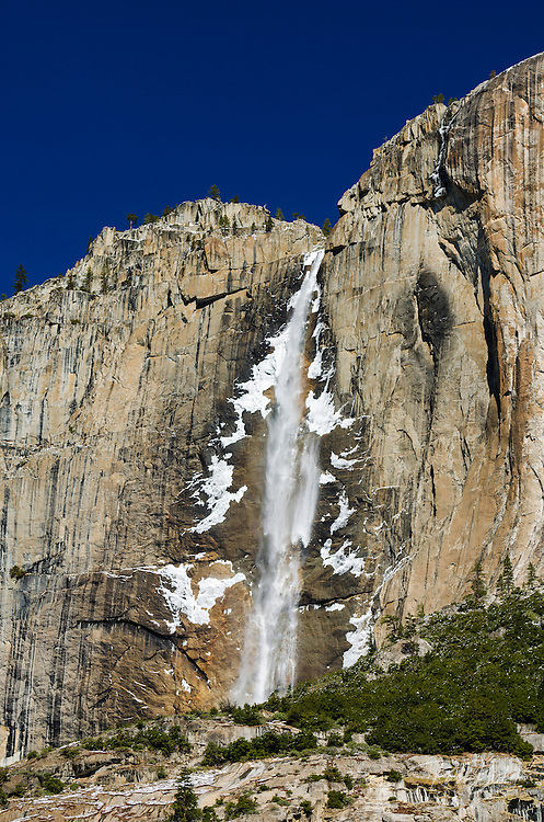 Ice falling from upper Yosemite Falls in winter, Yosemite National Park, California USA