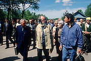 Russian Nobel prize novelist Alexander Solzhenitsyn walks through a park with well-wishers after arriving by train returning to his homeland June 5, 1994 in Khabarovsk, Russia. Solzhenitsyn was expelled from the Soviet Union in 1974 but returned after the fall of the Soviet Union.