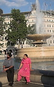 Sikh couple sitting, by fountain, Trafalgar Square, London, England