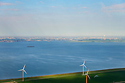 Nederland, Flevoland, Gemeente Almere, 27-08-2013; Almere-Pampus, Kustzone Almere. Zicht op het IJmeer met het forteiland Pampus, locatie voor een mogelijke IJmeerverbinding (IJmeerlijn). Foto richting IJburg, Amsterdam skyline en Waterland zichtbaar aan de horizon.<br /> Windmills along the coast in Almere Poort, viewed in direction Amsterdam. Isle of Pampus (fortress) in the middle of the IJmeer (water).  <br /> luchtfoto (toeslag op standaard tarieven);<br /> aerial photo (additional fee required);<br /> copyright foto/photo Siebe Swart.