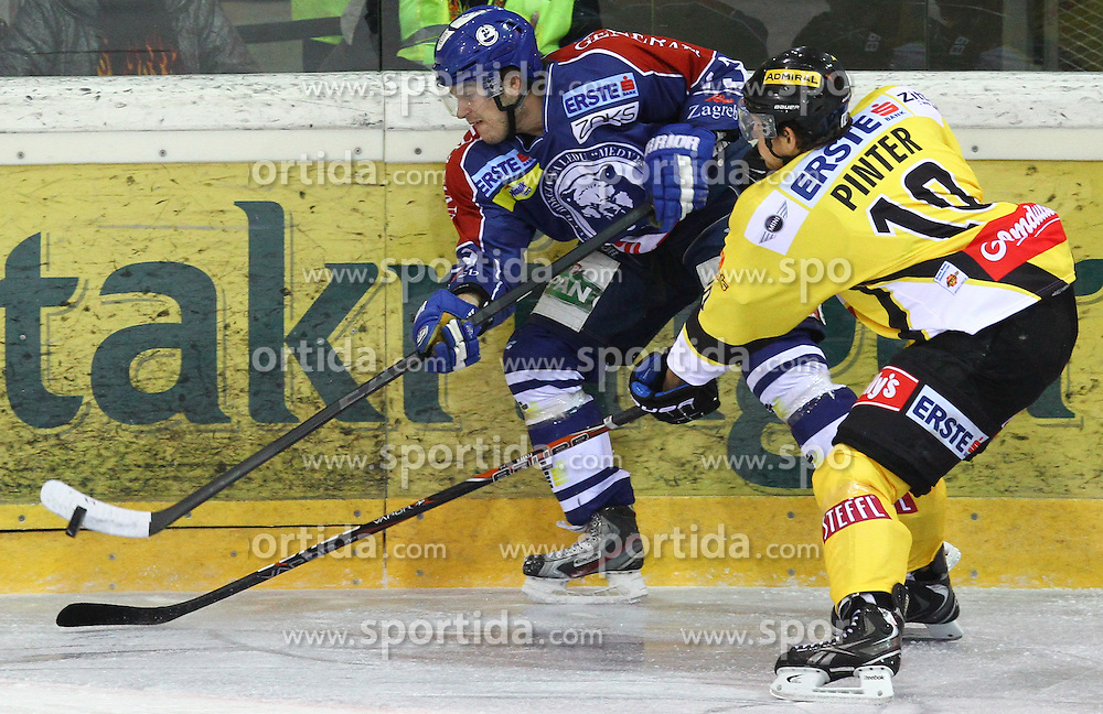 13.02.2013, Albert Schultz Eishalle, Wien, AUT, EBEL, UPC Vienna Capitals vs KHL Medvescak Zagreb, 6. Platzierungsrunde, im Bild Dennis Bozic, (KHL Medvescak Zagreb, #13) und Philipp Pinter, (UPC Vienna Capitals, #10)  // during the Erste Bank Icehockey League 6th placement Round match betweeen UPC Vienna Capitals and KHL Medvescak Zagreb at the Albert Schultz Ice Arena, Vienna, Austria on 2013/02/13. EXPA Pictures © 2013, PhotoCredit: EXPA/ Thomas Haumer