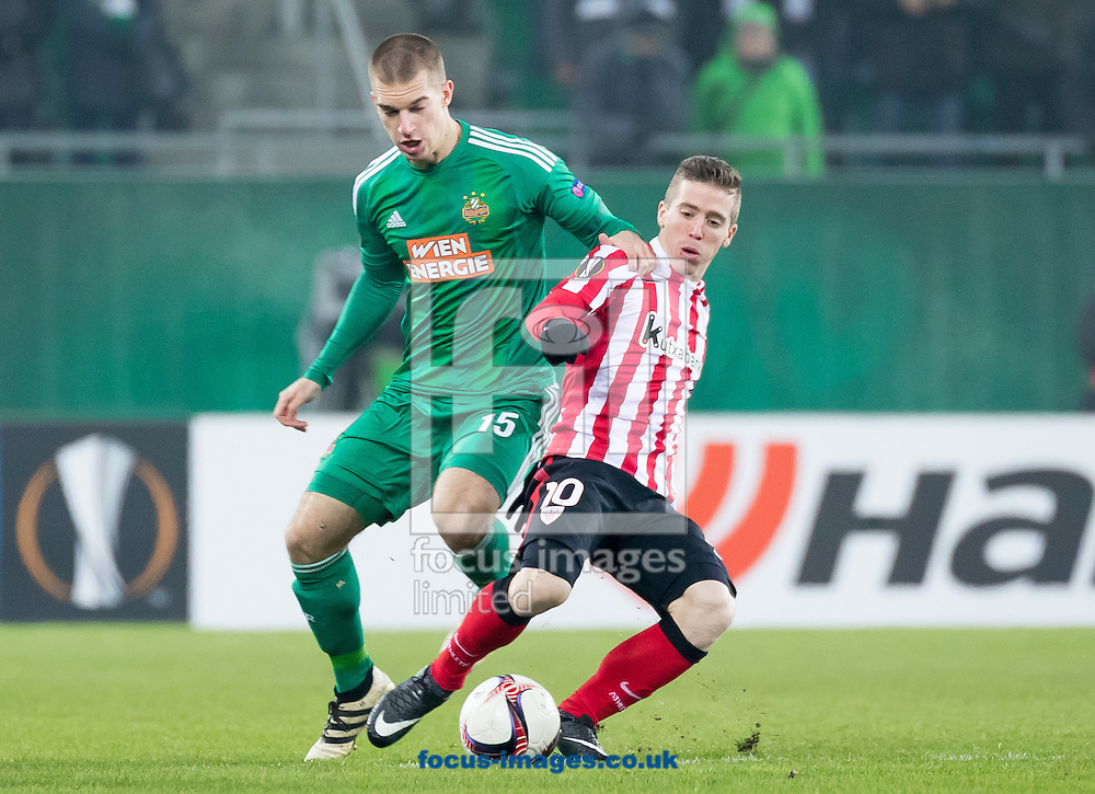 Srdjan Grahovac of Rapid Vienna and  Iker Muniain of Athletic Bilbao during the UEFA Europa League match at Allianz Stadion, Vienna<br /> Picture by EXPA Pictures/Focus Images Ltd 07814482222<br /> 08/12/2016<br /> *** UK &amp; IRELAND ONLY ***<br /> <br /> EXPA-PUC-161208-0048_2.jpg