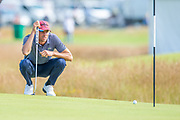 Benjamin Hebert (FRA) checks the line of his putt on the 14th green during the final round of the Aberdeen Standard Investments Scottish Open at The Renaissance Club, North Berwick, Scotland on 14 July 2019.