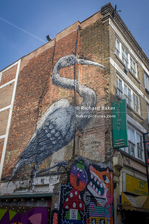 (Painted in 8 hours) Big Bird by the Belgian artist Roa on the side of a Balti restaurant in Hanbury Street, off Brick Lane, East London.