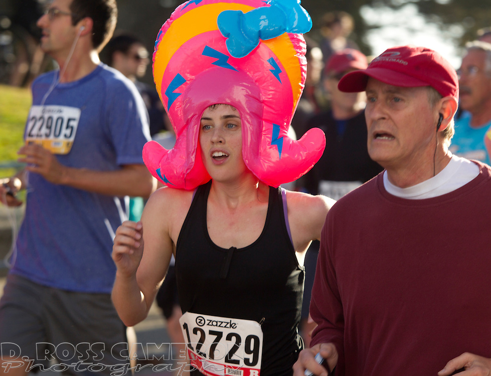 Emily Clay of Baltimore, Md., center, runs in an inflatable bonnet along Hayes Street during the 101st Bay to Breakers 12K footrace, Sunday, May 20, 2012 in San Francisco. More than 50,000 people participated in the 7.46-mile race, ranging from elite runners to those who ran in costume -- or nothing at all. (Photo by D. Ross Cameron)