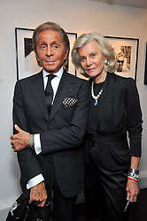Left to right, VALENTINO GARAVANI and MARINA CICOGNA at a private view of photographs by Marina Cicogna from her book Scritti e Scatti held at the Little Black Gallery, 3A Park Walk London SW10 on 16th October 2009.