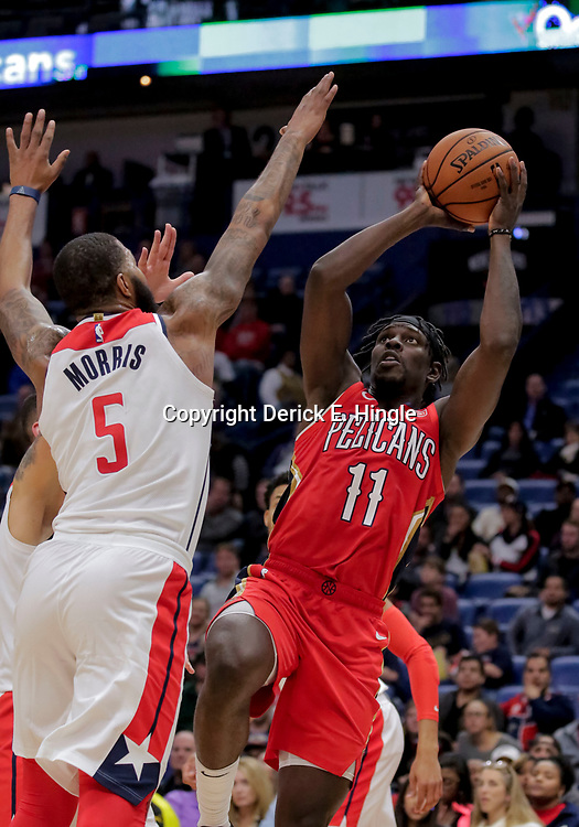 Nov 28, 2018; New Orleans, LA, USA; New Orleans Pelicans guard Jrue Holiday (11) shoots over Washington Wizards forward Markieff Morris (5) during the fourth quarter at the Smoothie King Center. Mandatory Credit: Derick E. Hingle-USA TODAY Sports