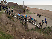 Members of the Eastbourne ramblers club on Cooden beach, Bexhill on Sea. 14 January 2016