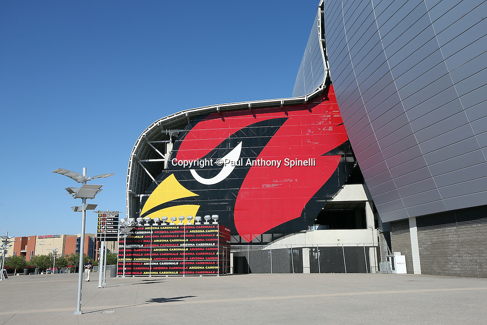 The Arizona Cardinals logo is painted in front of the University of Phoenix Stadium in this wide angle, general view photograph of the stadium exterior taken before the Arizona Cardinals 2015 NFL preseason football game against the San Diego Chargers on Saturday, Aug. 22, 2015 in Glendale, Ariz. The Chargers won the game 22-19. (©Paul Anthony Spinelli)