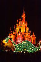 Pete's Dragon (and Elliott), Disney's Electrical Parade (with Cinderella Castle in back), Magic Kingdom, Walt Disney World, Orlando, Florida USA