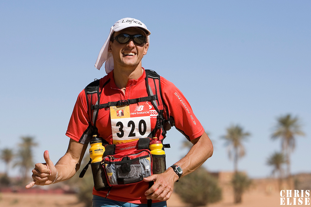 27 March 2007:  #320 Nicolas Margarot of France runs across the gorge of El Maharch during third stage of the 22nd Marathon des Sables between jebel El Oftal and jebel Zireg (20.07 miles). The Marathon des Sables is a 6 days and 151 miles endurance race with food self sufficiency across the Sahara Desert in Morocco. Each participant must carry his, or her, own backpack containing food, sleeping gear and other material.