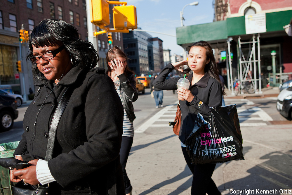 Women walking down 8th Avenue on a sunny winter day in downtown Manhattan.