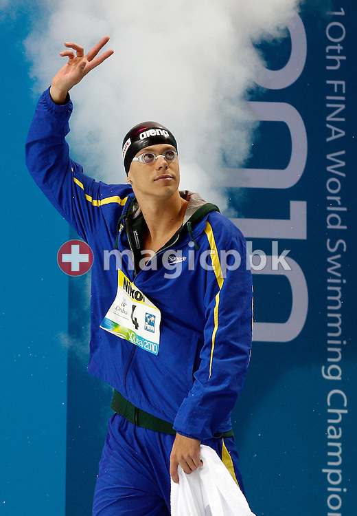 Winner Cesar CIELO FILHO of Brazil walks in before competing in the men's 100m Freestyle Final during the 10th FINA World Swimming Championships (25m) at the Hamdan bin Mohammed bin Rashid Sports Complex in Dubai, United Arab Emirates, Sunday, Dec. 19, 2010. (Photo by Patrick B. Kraemer / MAGICPBK)