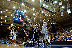 Virginia guard/forward Mamadi Diane (24) and Duke forward Lance Thomas (42) go up for a rebound.  The Duke Blue Devils defeated the Virginia Cavaliers 87-65 in men's basketball at Cameron Indoor Stadium on the campus of Duke University in Durham, NC on January 13, 2008.