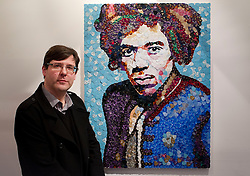 © Licensed to London News Pictures. 02/04/2013. London, UK. Manchester based mosaic artist Ed Chapman is seen with his portrait of Jimi Hendrix, made from guitar plectrums, in a pop-up shop set up to celebrate a new album by the late guitar legend in London today (02/04/2013). The shop, called 'People, Hell and Angels' 'located near London's Carnaby Street, runs from the 1st of April until the 12th of April 2013 and features memorabilia, music and photographs of the guitarist and singer who died in 1970 of a drug overdose. Photo credit: Matt Cetti-Roberts/LNP