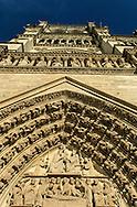 Paris. Notre dame cathedral main front side; gargoyls and sculpturs  Paris  France
